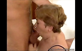 Granny engulfing well supplied with an increment of acquiring her bosom screwed