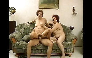 2 grandmas enjoy a clog added to his cock.